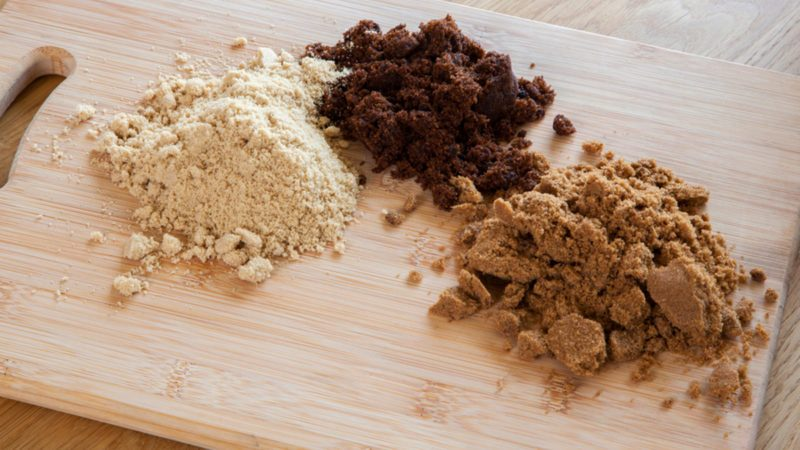Different types of sugar - dark brown soft, light brown soft & molasses - natural unrefined cane sugar.
