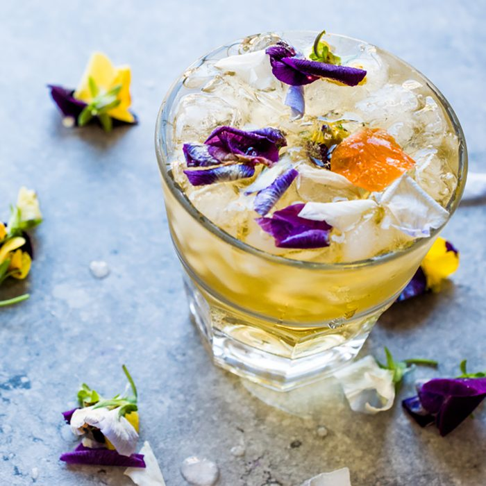 Herbal Iced Tea Cocktail with Edible Flowers and Crushed Ice