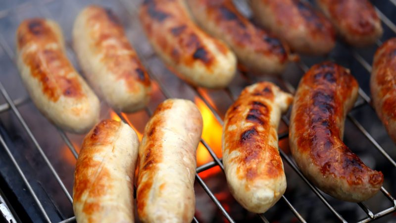 Nicely grilled sausages on a whole background.