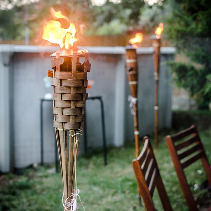 Burning tiki torch in the backyard