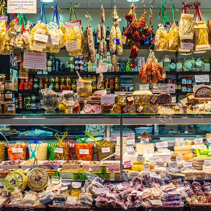 Various cheese and other quality Italian products for sale in Mercato Orientale, famous market in central Genoa