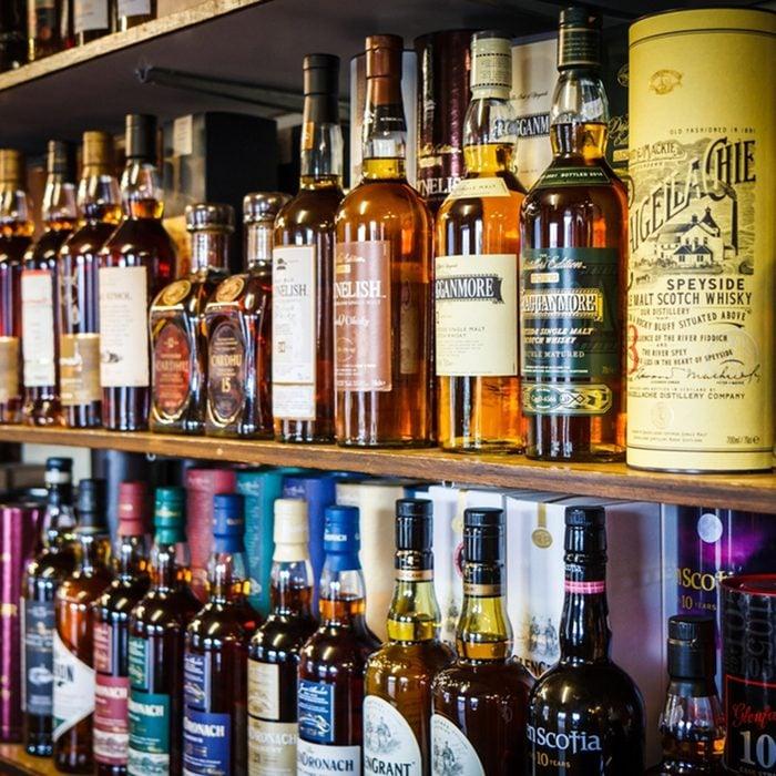 Various bottles of Scotch whisky on the shelf