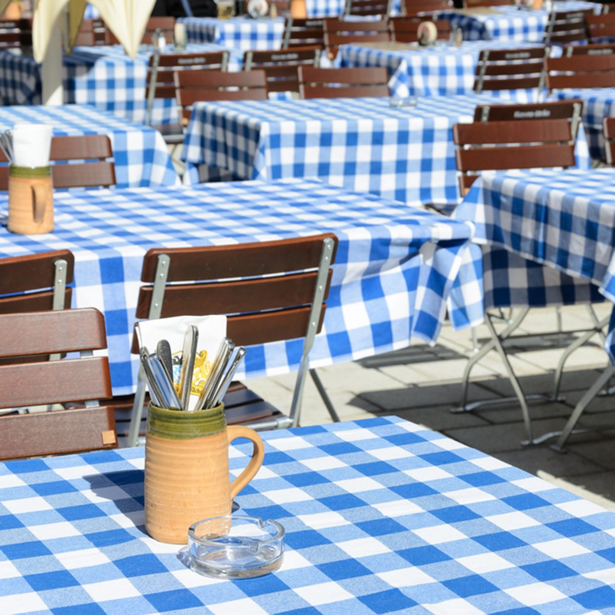 Empty Bavarian Beer garden with blue white tablecloth.