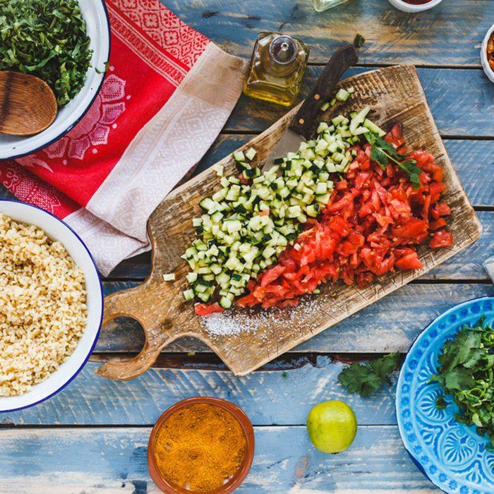 Cut Vegetables and bulgur grains ready to prepare salad.