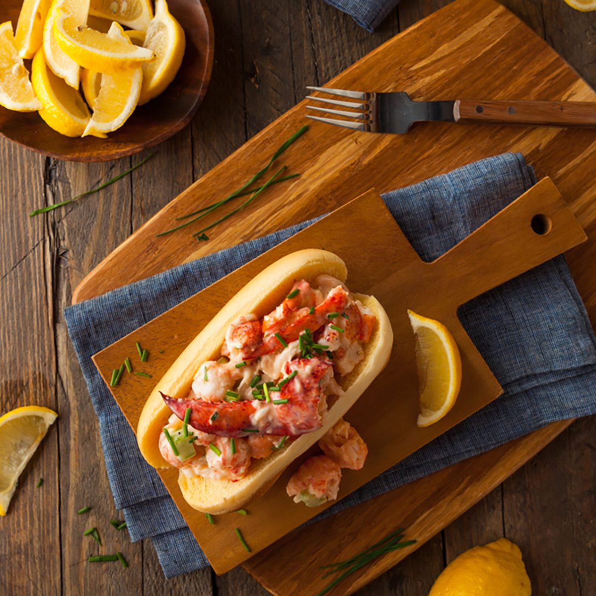 Homemade New England Lobster Roll with Lemons