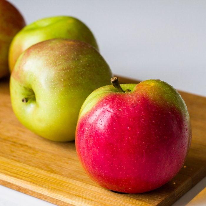 Idared Fresh apples on a cutting board.