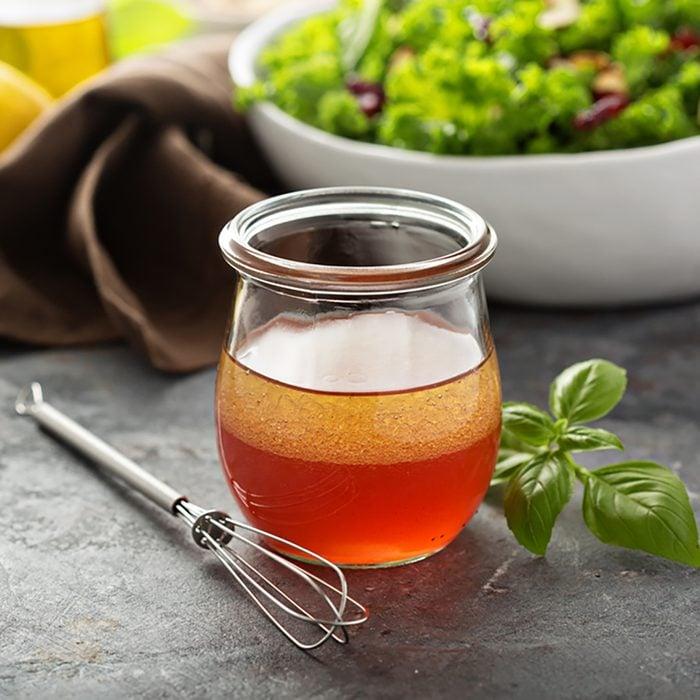 Homemade salad dressing vinaigrette with raspberry and pomegranate juice