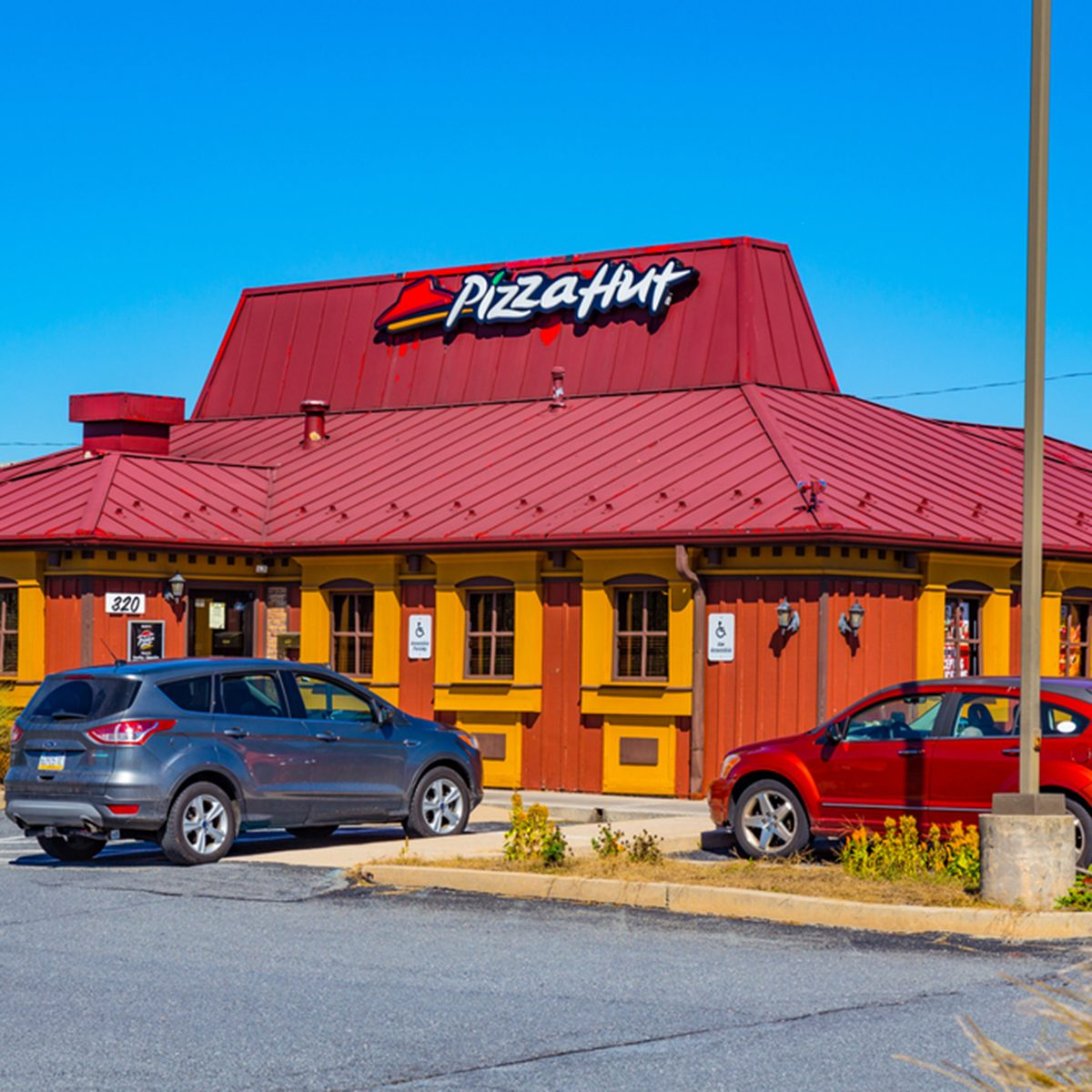 A Pizza Hut restaurant offers fresh pizzas to eat in the restaurant as well as to carryout at one of the chain's restaurants.