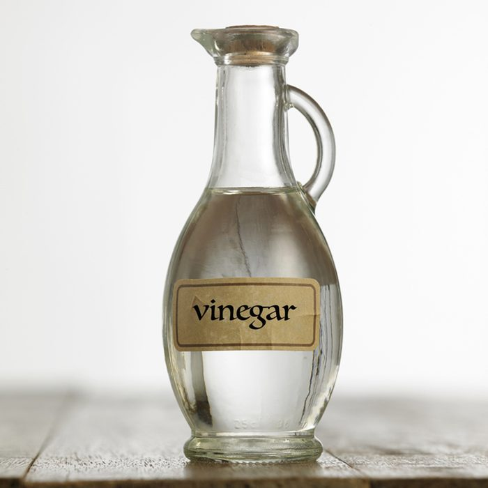 White vinegar on the wooden table top