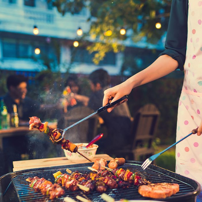 Asian woman are cooking for a group of friends to eat barbecue;