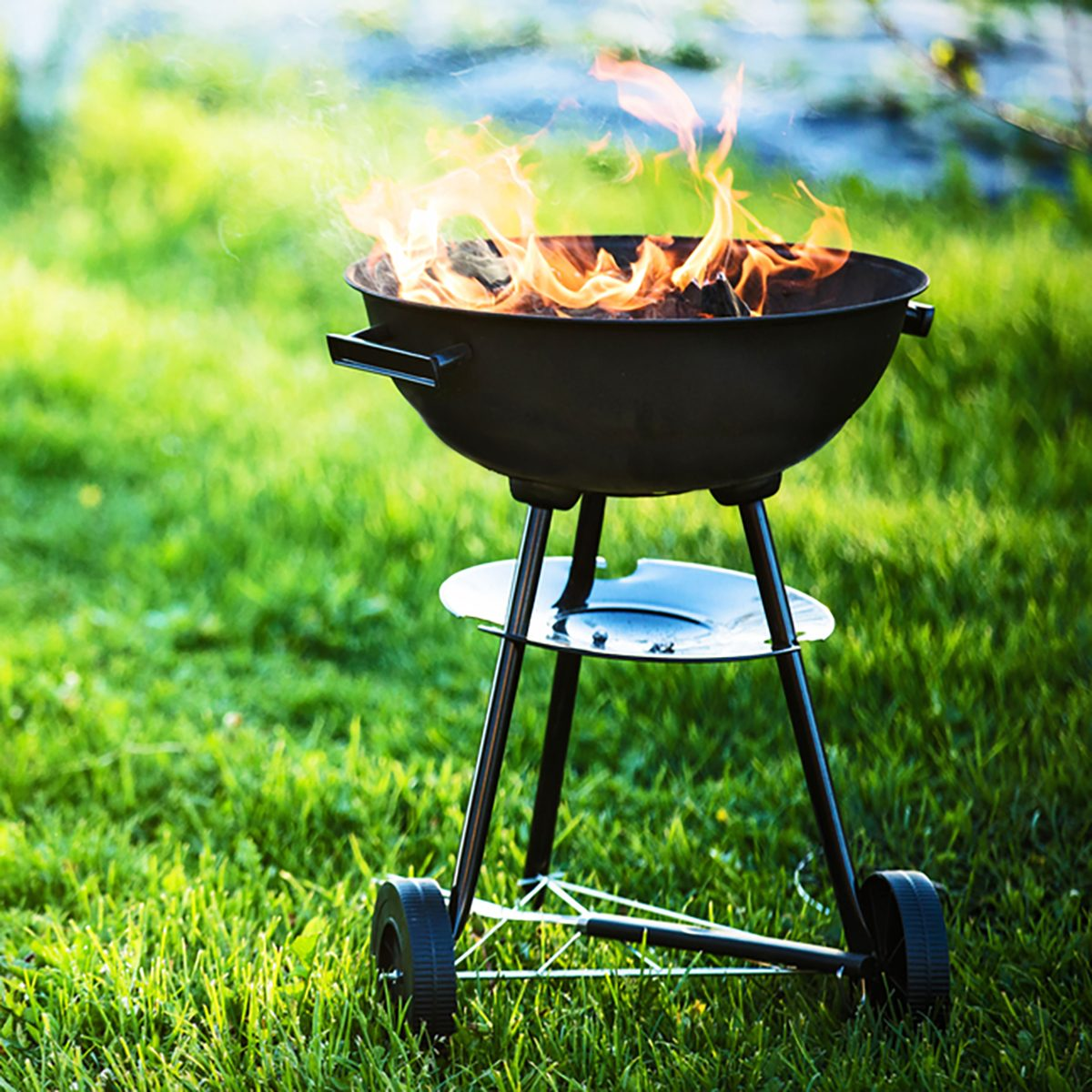Barbecue grill with fire on nature,