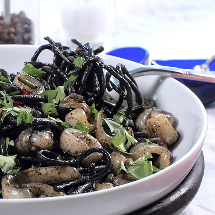 View of delicious black pasta with squids (cuttlefish) and ink
