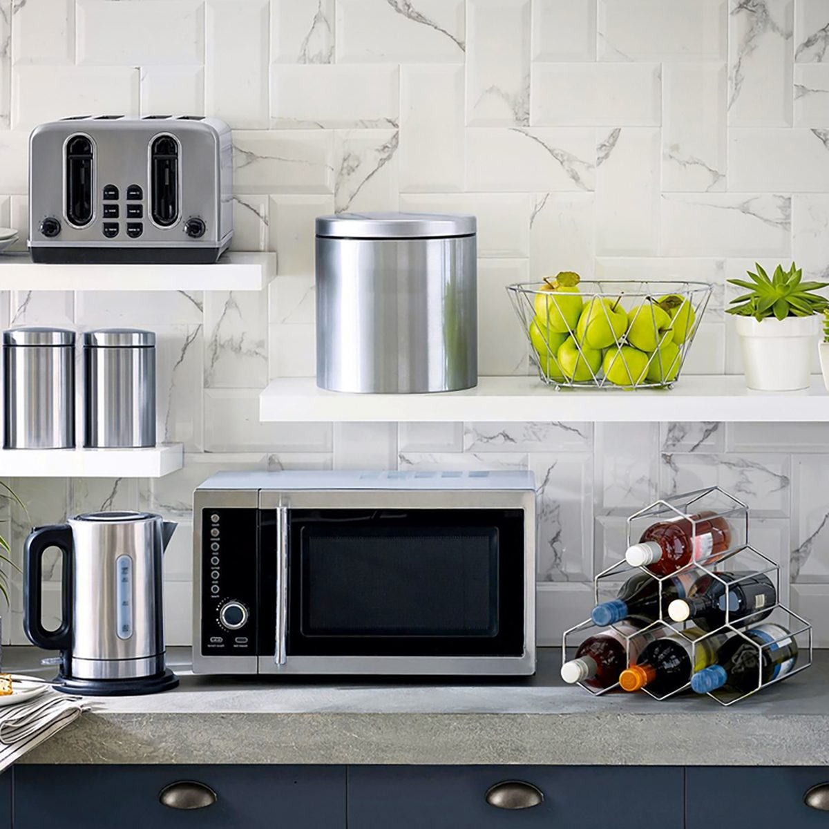 Microwave the kitchenware home appliance isolated in the kitchen interior;