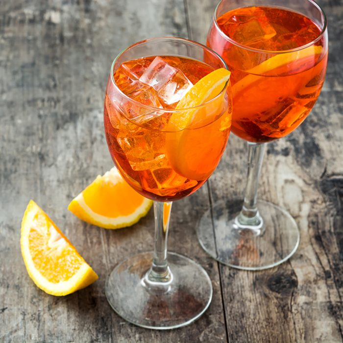 Aperol spritz cocktail in glass on wooden table