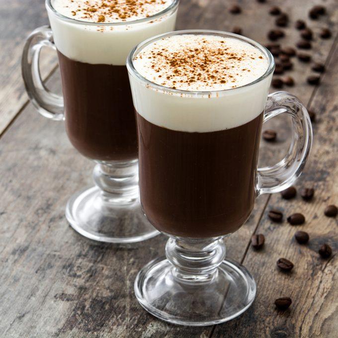 Irish coffee in glass on wooden table