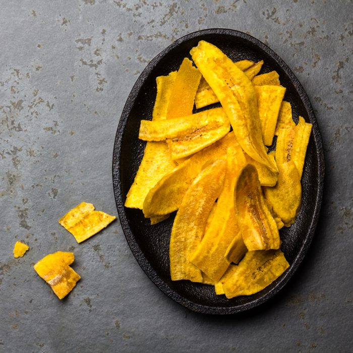 Healthy Homemade banana Plantain Chips on black plate