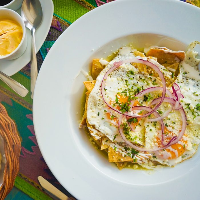 Traditional Mexican Mexico Breakfast of Chilequilas, Eggs, Bread