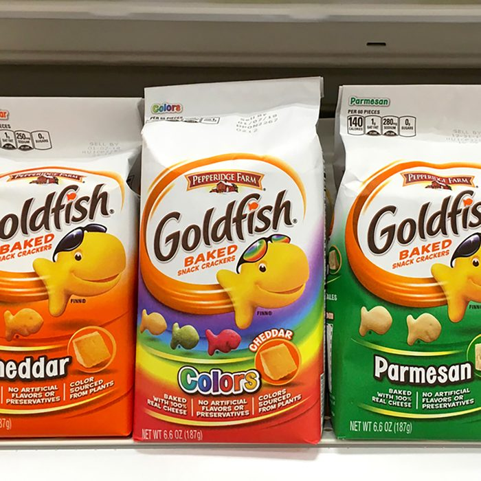 Grocery shelf with packages of Goldfish cheese crackers.