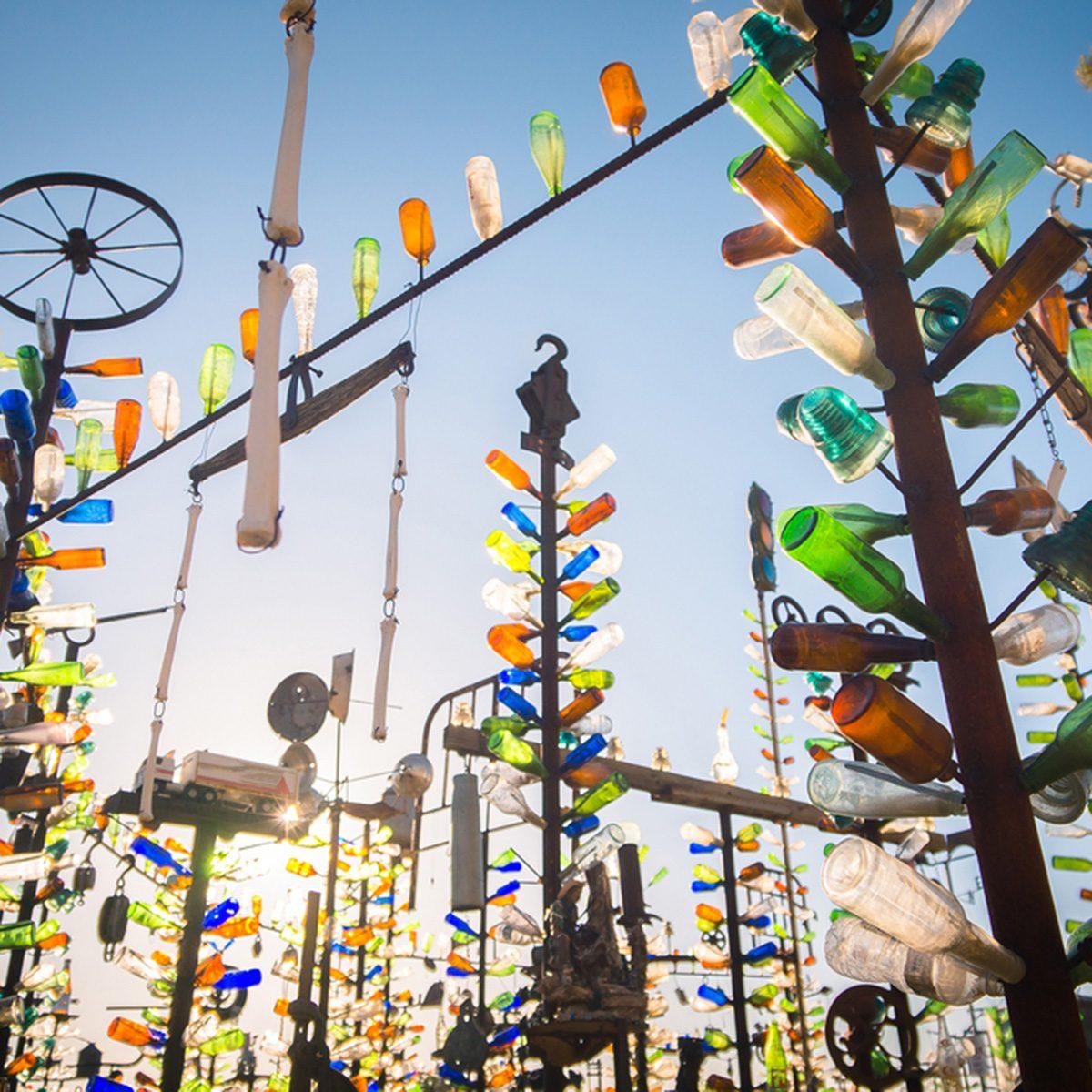 Art installation with collected beer bottle at Elmer's Bottle Tree Ranch, San Bernardino, California.; Shutterstock ID 752773033; Job (TFH, TOH, RD, BNB, CWM, CM): TOH