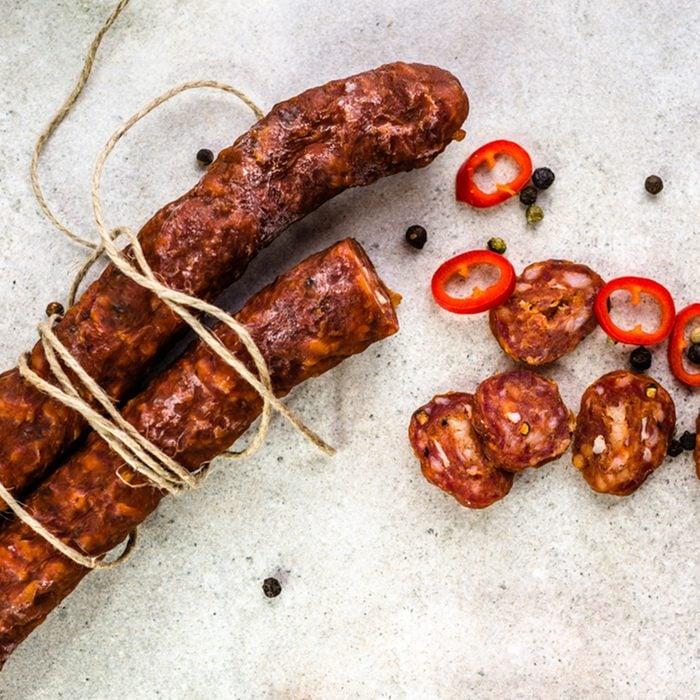 Food from spain, chorizo sausage slices or salami pepperoni, traditional spanish tapas, overhead.