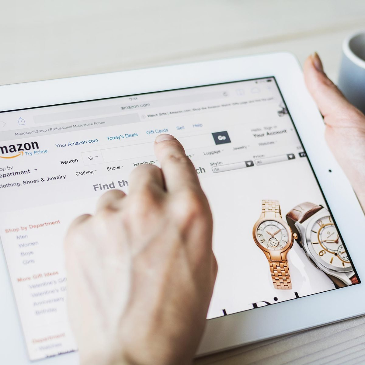 Person browsing Amazon on a tablet