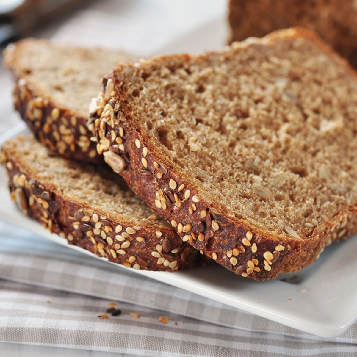 Sliced bread with sunflower seeds and sesame on a plate
