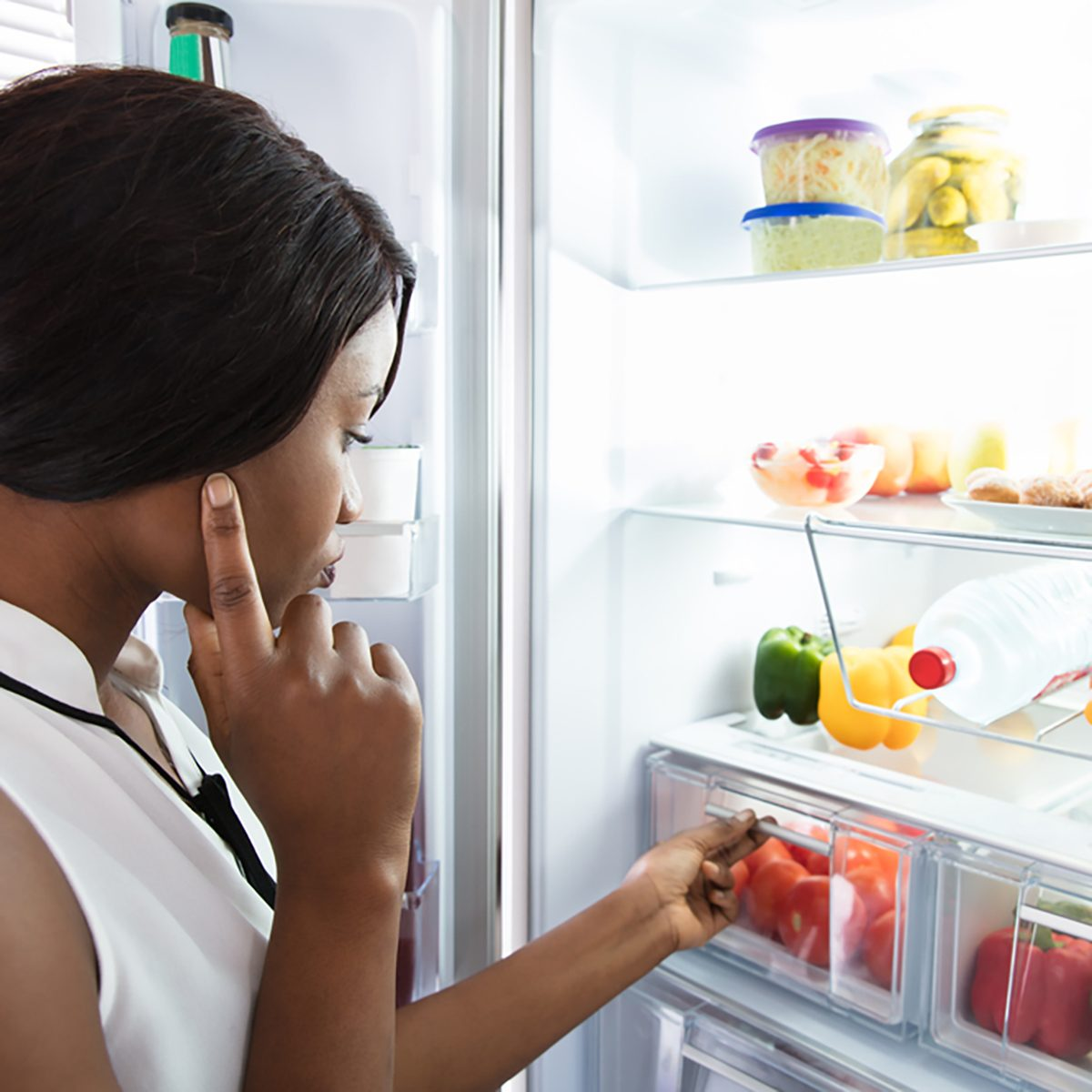 Young Woman Looking In Fridge At Kitchen; Shutterstock ID 762123727; Job (TFH, TOH, RD, BNB, CWM, CM): TOH Amazon Echo