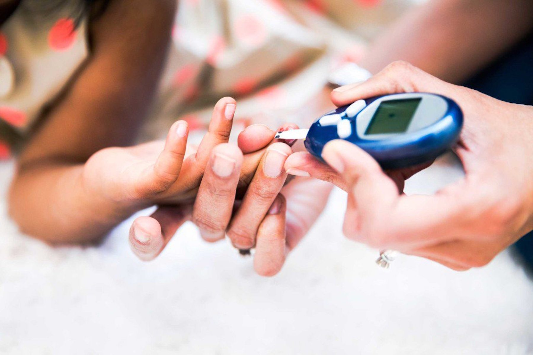 person with diabetes taking their test