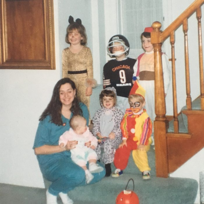 five children and adult in Halloween costumes