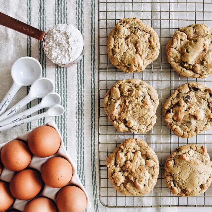 fresh baked cookies with eggs and measuring spoons