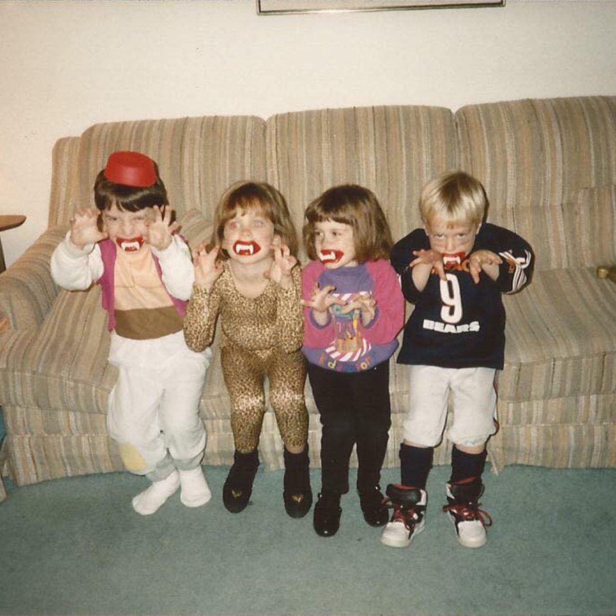 four children dressed in Halloween costumes