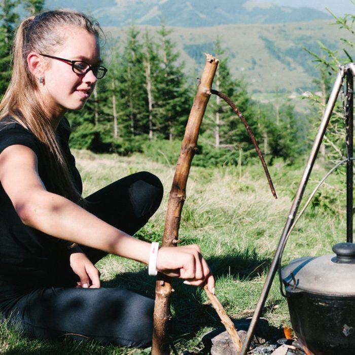 woman Cook hiking boiler fire.; Shutterstock ID 1116311867; Job (TFH, TOH, RD, BNB, CWM, CM): TOH
