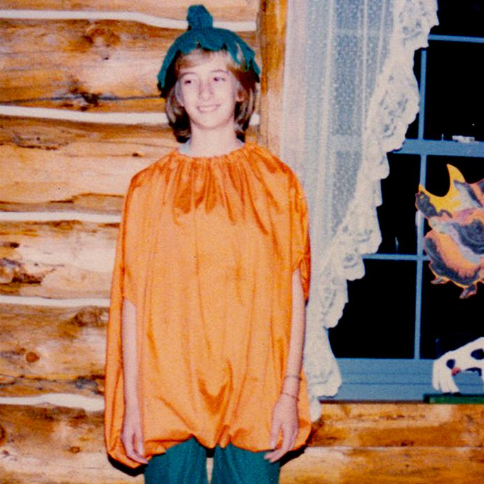girl dressed as a pumpkin for Halloween