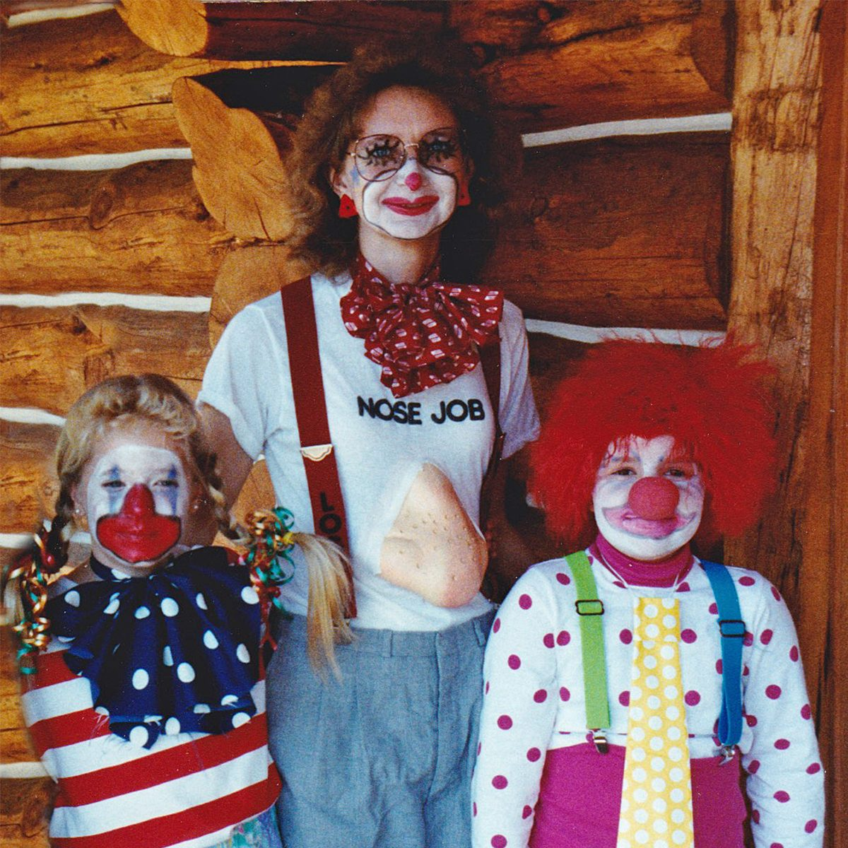 woman and two children dressed in costumes for Halloween