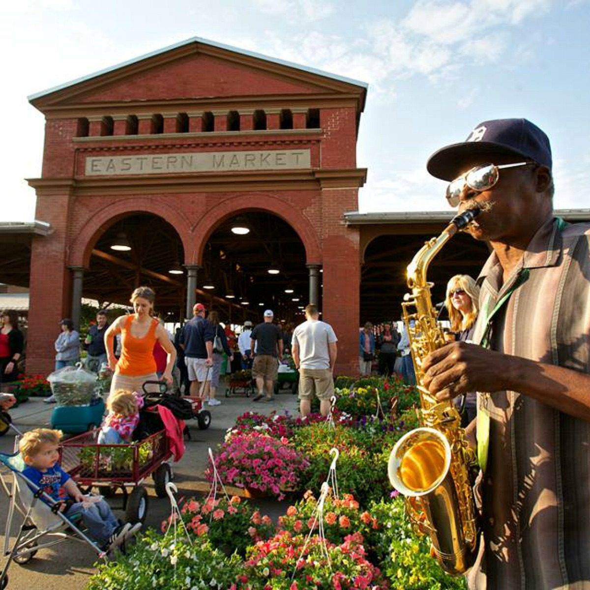 Man playing the saxophone at Eastern Market