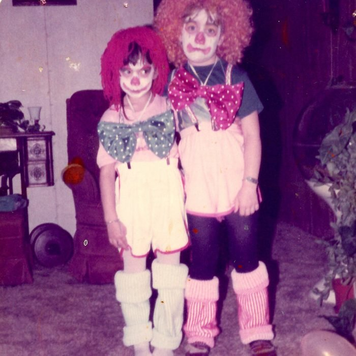two children dressed as a clown and a raggedy anne for Halloween