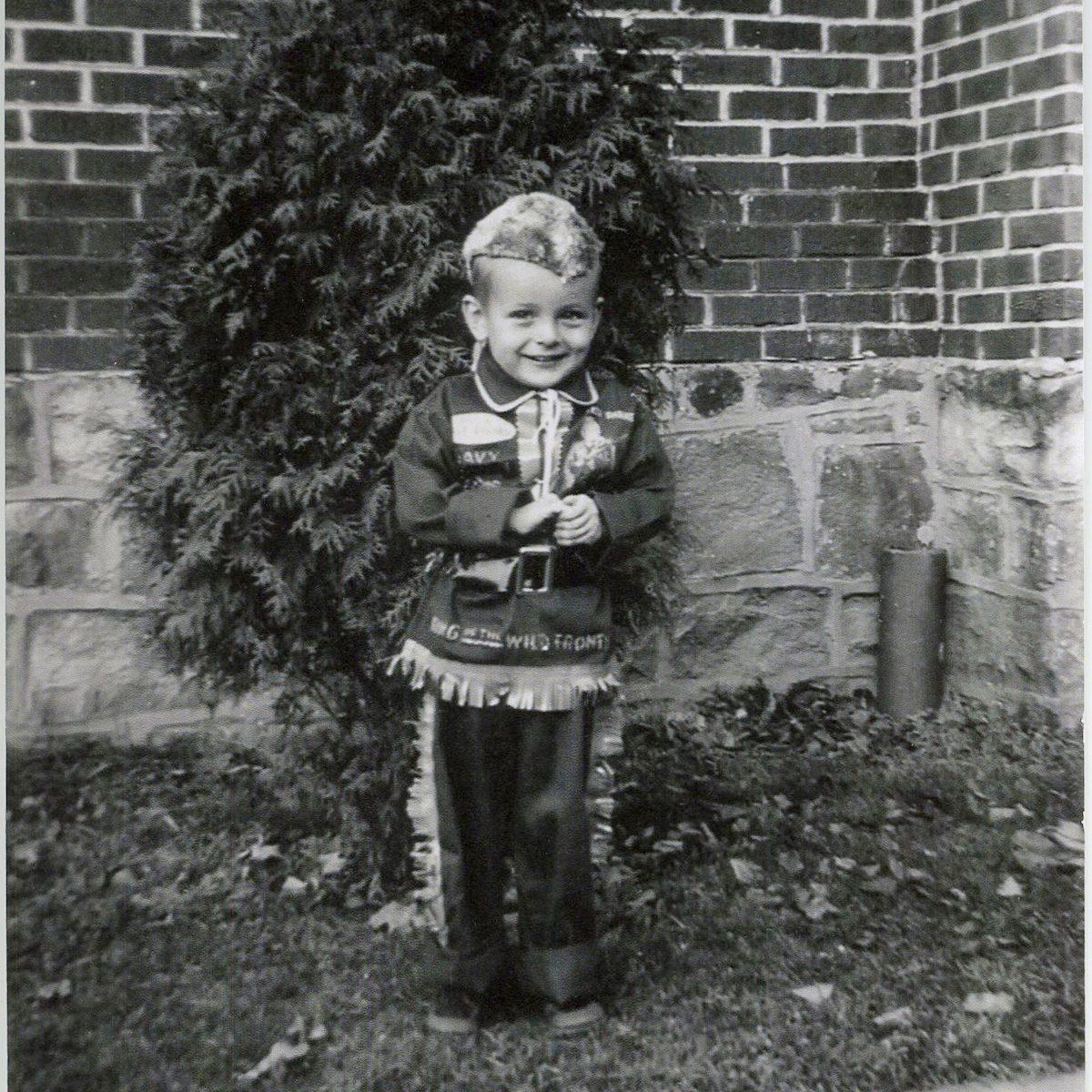 small boy in Davey Crocket Halloween Costume