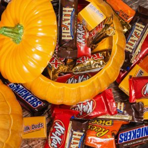 Decorative pumpkins filled with assorted Halloween chocolate candy made by Mars, Incorporated and the Hershey Company.