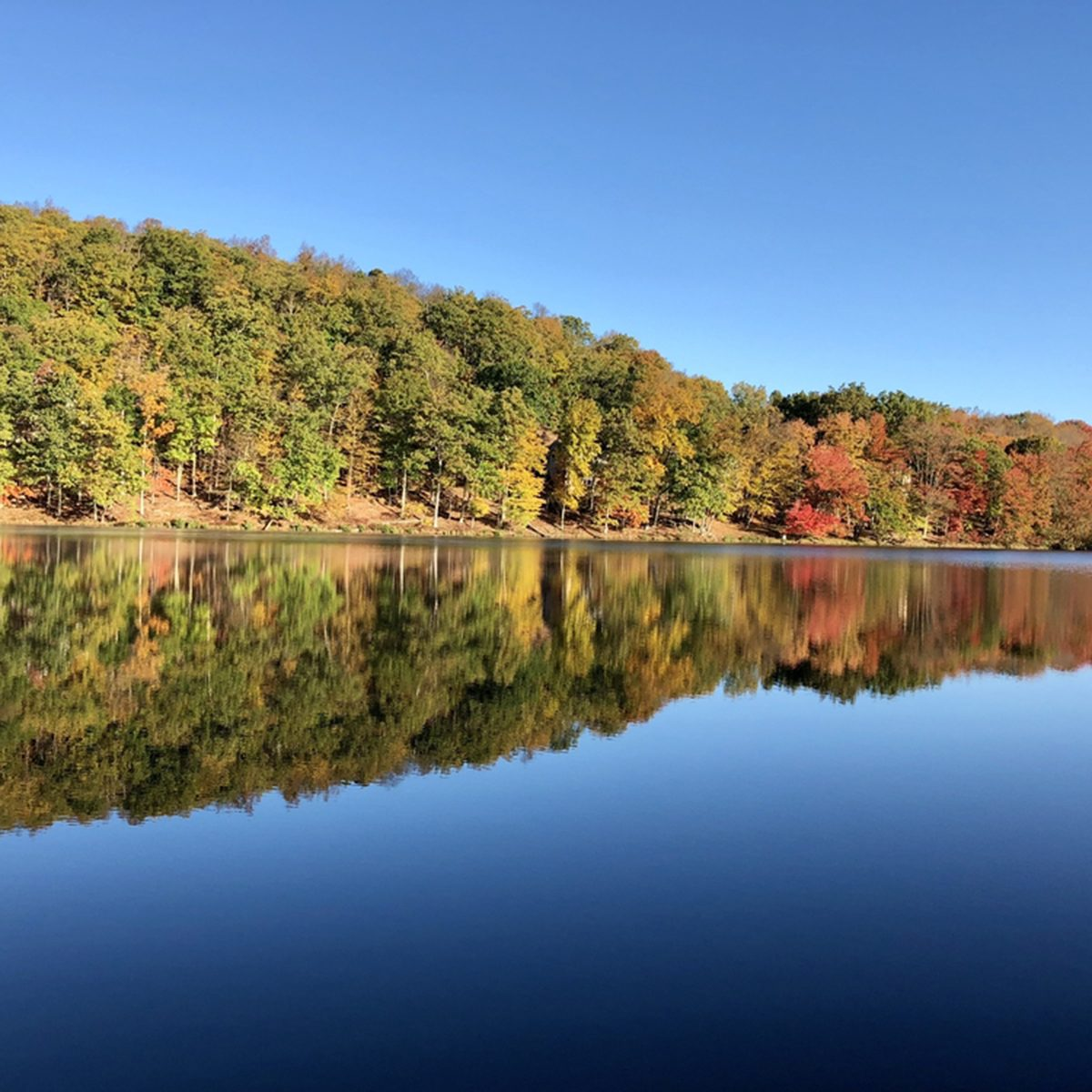 Serene lake discovered in the Pocono Mountains on a beautiful Fall morning.