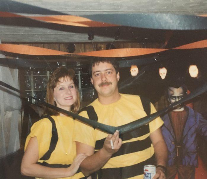 two people dressed in bee Halloween costume