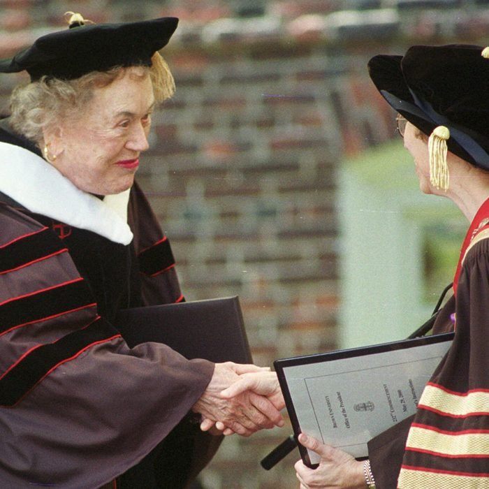 Julia Child, center, is congratulated after receiving an honorary doctorate of humane letters from Brown University in Providence, R.I., at graduation ceremonies