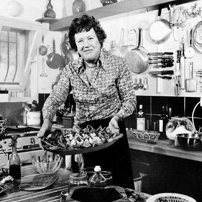 Child American television chef Julia Child shows a salade nicoise she prepared in the kitchen of her vacation home in Grasse, southern France