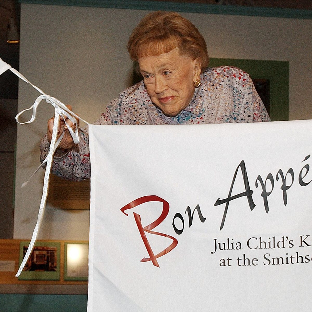 Julia Child pulls on apron strings to open her kitchen exhibition at the Smithsonian's National Museum of American History in Washington