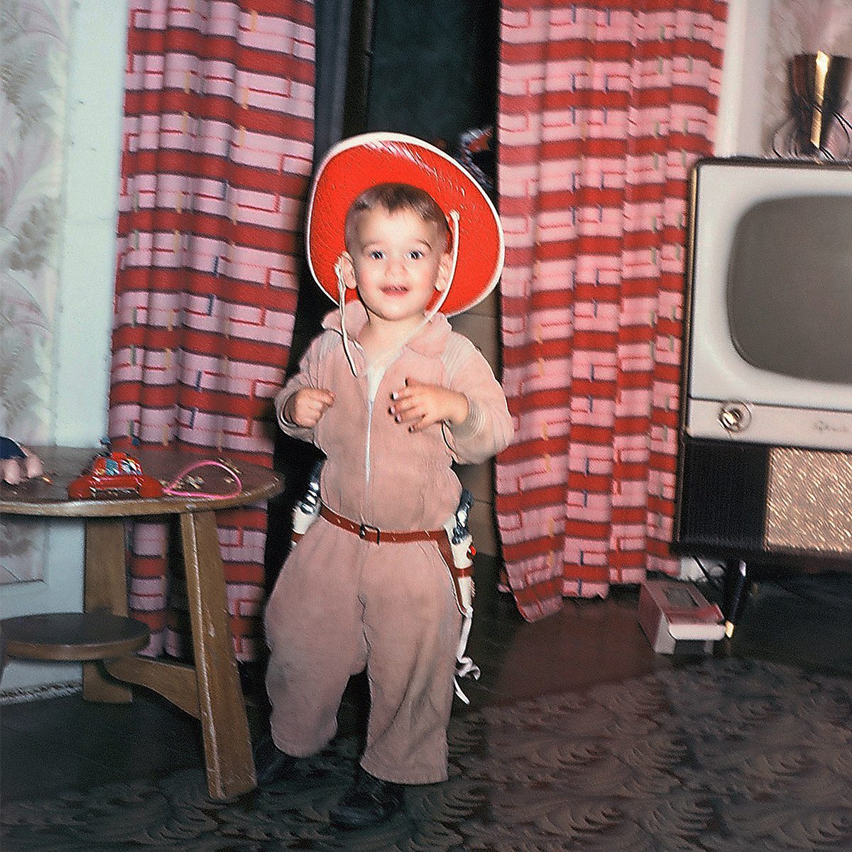 child in a cowboy costume for Halloween