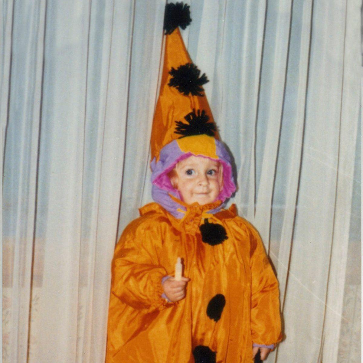 child dressed in Halloween costume