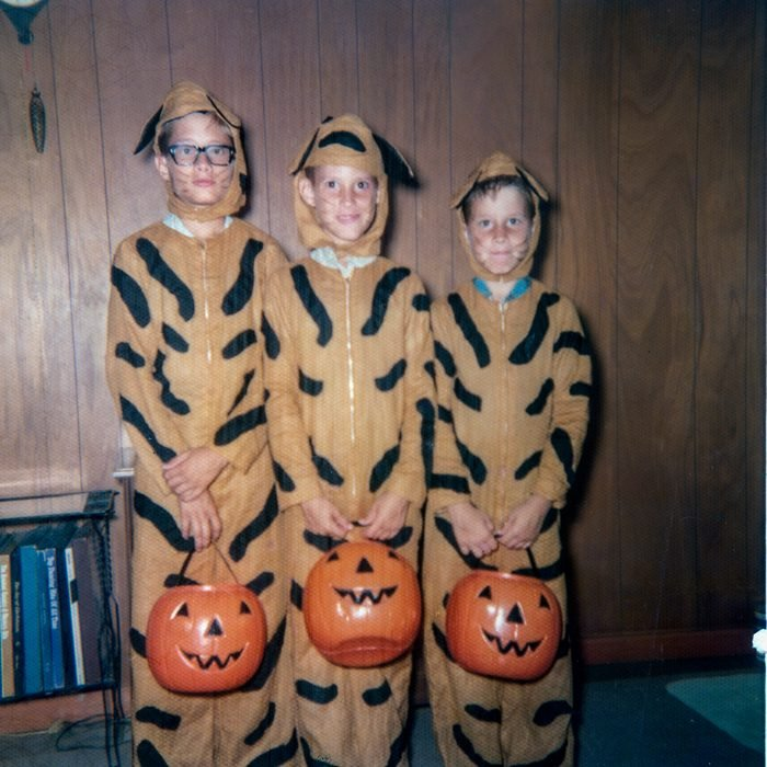 three children dressed as tiger for Halloween