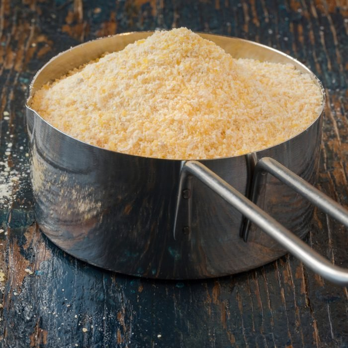 Corn meal in a measuring cup