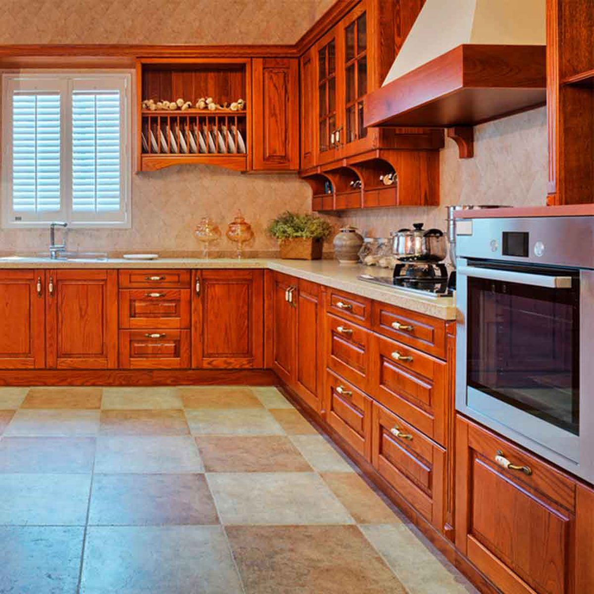 Warmly lit kitchen with wooden cabinets