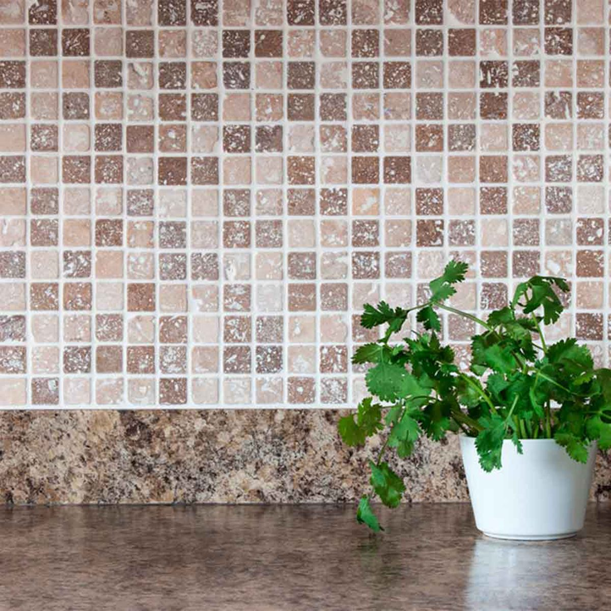 Stone counter with a matching grey and brown tiled backsplash