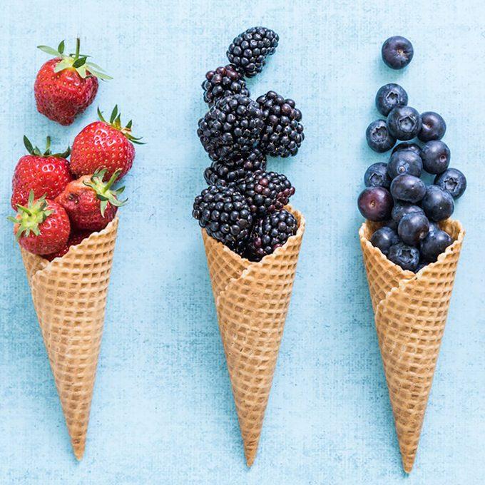 ice cream cones filled with fruit